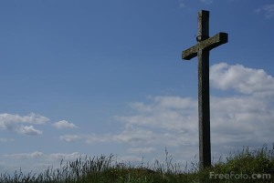 Picture of a wooden Christian cross on Saint Cuthbert's Isle, Holy Island, Northumberland. St Cuthbert's Isle was a small island used as a retreat by both Aidan and Cuthbert.
